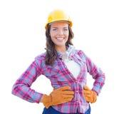 女性建筑工人佩带的手套和安全帽 库存照片