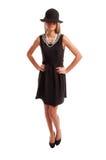 女性式样摆在一件黑礼服 免版税库存图片