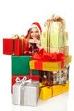 女性微笑的堆圣诞节礼物 免版税图库摄影