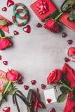 女性情人节或约会辅助部件和爱标志在红颜色:鞋子,镯子,礼物,首饰,玫瑰开花,蜡烛, c 库存图片