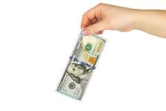 女性手举行100美元在白色背景的美元 关闭 库存图片