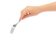 女性手拿着一把叉子 背景查出的白色 免版税库存照片