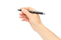 女性手拿着一支笔 背景查出的白色 库存图片