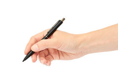 女性手拿着一支笔 背景查出的白色 库存照片