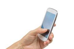 女性手拿着巧妙的电话被隔绝 免版税库存图片