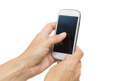 女性手是一个巧妙的电话的感人的触摸屏幕 免版税库存照片