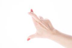 女性手显示在白色的好运标志 库存图片