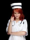女性护士指向 库存照片
