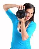 女性摄影师射击您 库存照片