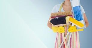 女性擦净剂藏品刷子的中央部位 免版税图库摄影