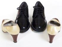 女性查出的男性鞋子穿上鞋子白色 免版税图库摄影