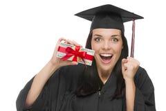 女性毕业生藏品堆礼物包裹了一百美元Bil 免版税图库摄影