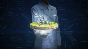 女性研究员,工程师开放棕榈,风力在地面上的能量盘区 环境友好的能量 股票录像