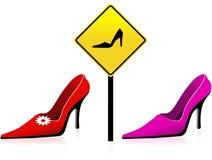 女性穿上鞋子符号 免版税库存图片