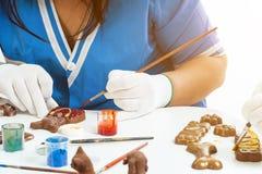 女性糖果商油漆 免版税图库摄影