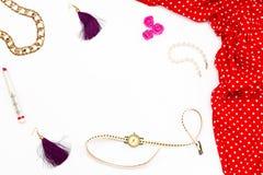 女性红色礼服、耳环、手表、珍珠镯子和唇膏在白色背景 免版税图库摄影