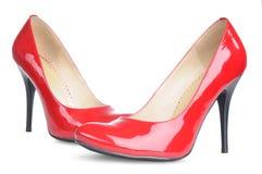 女性脚跟高查出的红色鞋子 免版税图库摄影