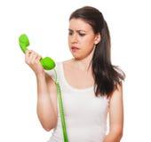女性获得的电话强调的年轻人 免版税库存照片