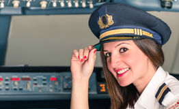 年轻女性试验为起飞准备 免版税库存图片