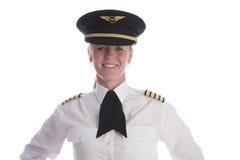 女性试验佩带的一致的帽子 库存图片