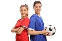 女性足球运动员和一个男性足球运动员 免版税图库摄影