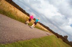 女性跑步 免版税图库摄影