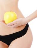女性身体和苹果 免版税库存图片