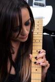 女性音乐家吉他弹奏者 免版税库存图片