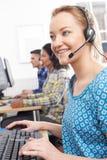 女性顾客服务代理在电话中心 图库摄影