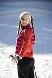女性skiier雪 免版税图库摄影