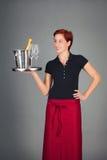 女服务员服务香槟 免版税库存照片