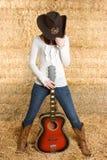 女牛仔吉他 图库摄影