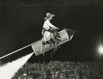 女牛仔在火箭离开 库存照片