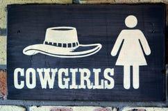 女牛仔洗手间 库存照片