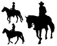 女牛仔骑乘马 库存图片
