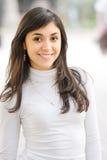 女衬衫女孩微笑的白色 免版税库存照片