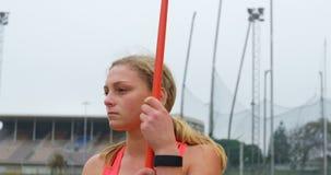 女运动员身分用在运动会比赛地点4k的标枪棍子 影视素材