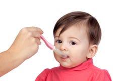 女婴吃 免版税库存图片