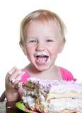 女婴和她的生日蛋糕 免版税库存照片
