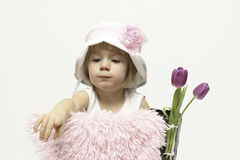 女婴和郁金香 免版税库存图片