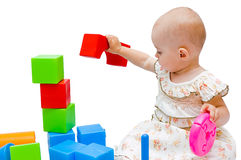 女婴她小的使用的玩具 免版税库存图片