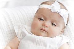 女婴新的佩带的白色 库存照片