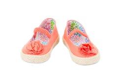女婴橙色织品运动鞋 免版税库存图片