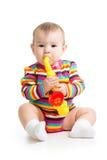 女婴音乐使用的玩具 库存照片