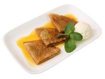 奶油色冰橙色薄煎饼调味汁 免版税库存图片