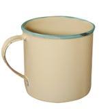 奶油色和绿色搪瓷杯子 库存图片