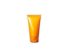 奶油色屏蔽晒日光浴的管 库存图片