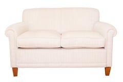 奶油色沙发白色背景 库存图片