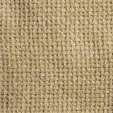 奶油色浅褐色的粗糙的机织织物背景 免版税库存照片
