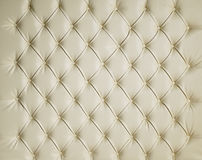 奶油色皮革被填塞的散布的豪华背景 免版税图库摄影